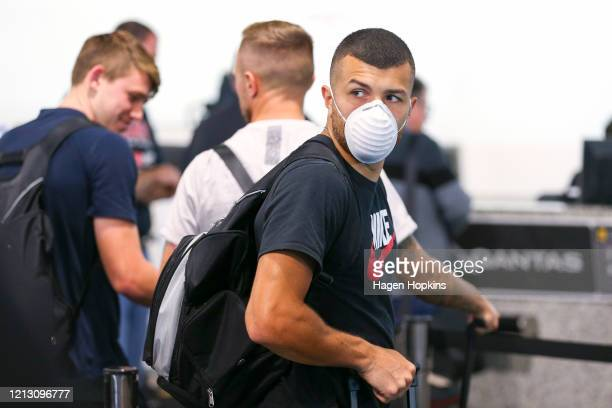 Jaushua Sotirio wears a face mask at Wellington Airport, prior to the departure of the Wellington Phoenix team to Sydney to complete the remainder of...