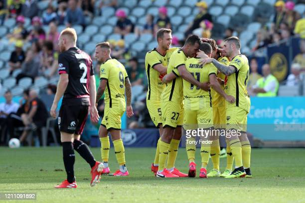 Jaushua Sotiro of Wellington Phoenix celebrates a goal with team mates during the round 222 ALeague match between the Central Coast Mariners and the...