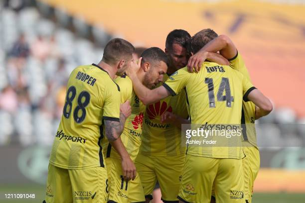 Jaushua Sotiro of Wellington Phoenix celebrates his goal with team mates during the round 22 A-League match between the Central Coast Mariners and...