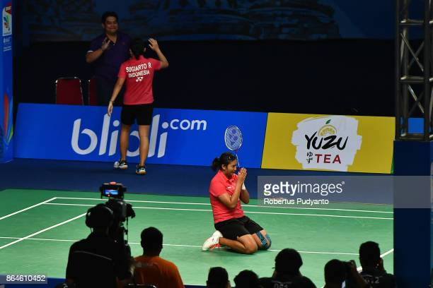 Jauza Fadhila Sugiarto and Ribka Sugiarto of Indonesia celebrate victory after beating Xia Yuting and Zhang Shuxian of China during Women's Doubles...