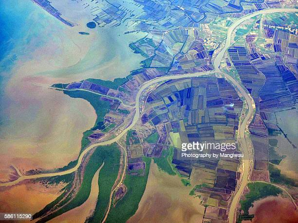 java sea deltas - soil erosion stock photos and pictures
