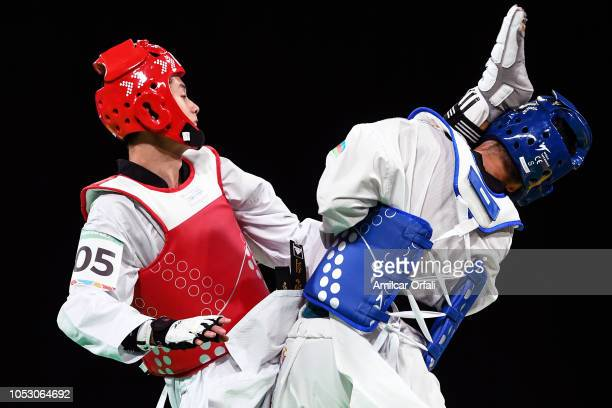 Javad Aghayev of Azerbaijan and Wonhee Cho of Korea compete in the Men's 63kg Semifinals during day 3 of Buenos Aires Youth Olympics 2018 at Oceania...