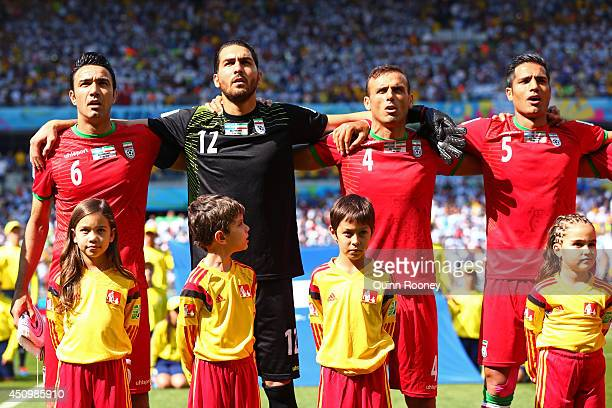 Javad Nekounam Alireza Haghighi Jalal Hosseini and Amirhossein Sadeghi of Iran sing the National Anthem during the 2014 FIFA World Cup Brazil Group F...