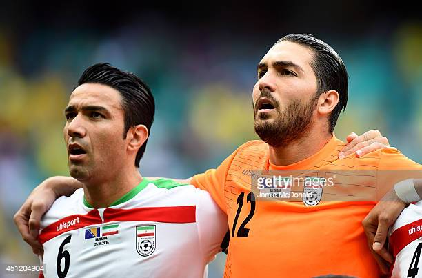 Javad Nekounam and Alireza Haghighi of Iran sing the National Anthem prior to the 2014 FIFA World Cup Brazil Group F match between Bosnia and...