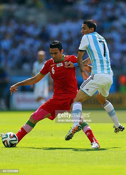 Javad Nekounam of IranÊin action against Angel Di Maria of Argentina during the 2014 FIFA World Cup Brazil Group F match between Argentina and Iran...