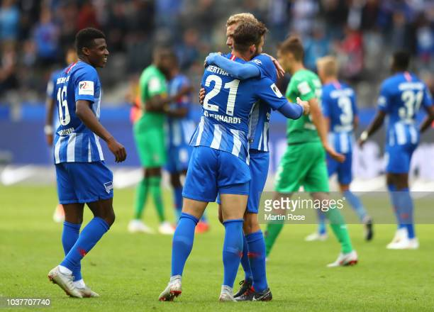 Javairo Dilrosun Marvin Plattenhardt and Fabian Lustenberger of Hertha BSC celebrate victory after the Bundesliga match between Hertha BSC and...