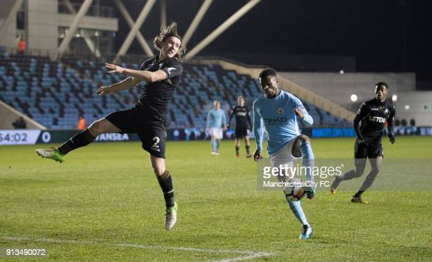 Javairo Dilrosun of Manchester City and Aaron Lewis of Swansea during the Premier League 2 match between Manchester City and Swansea City match at...