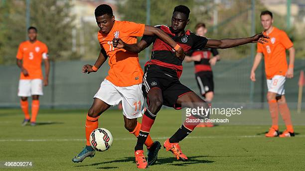 Javairo Dilrosun of Netherlands and Idrissa Toure of Germany battle for the ball during the U18 four nations friendly tournament match between...