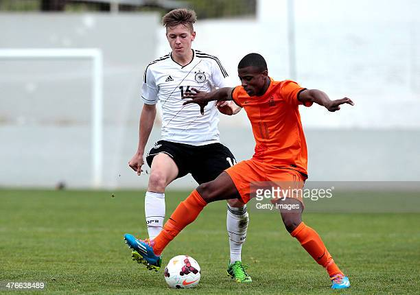 Javairo Dilrosun of Netherlands challenges Jannes Vollert of Germany during the UEFA Under16 Tournament match between U16 Portugal v U16 Germany on...