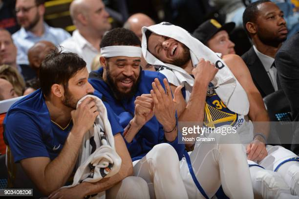 JaVale McGee and Stephen Curry of the Golden State Warriors smile and laugh from the bench during the game against the Denver Nuggets on January 8...
