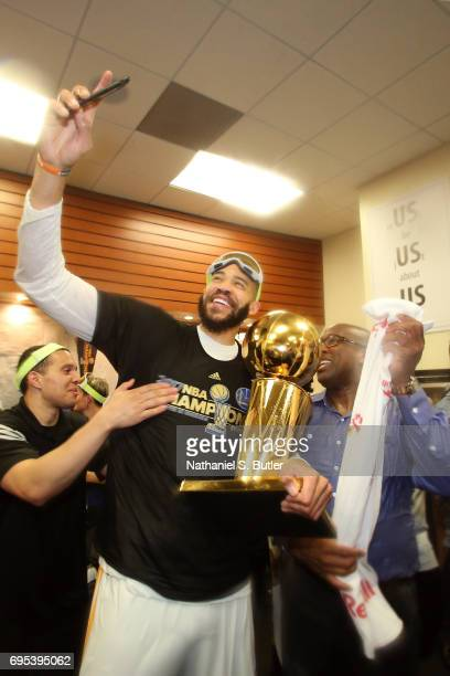 JaVale McGee and Steve Kerr of the Golden State Warriors celebrate with the Larry O'Brien Trophy in the locker room after winning the NBA Championsip...