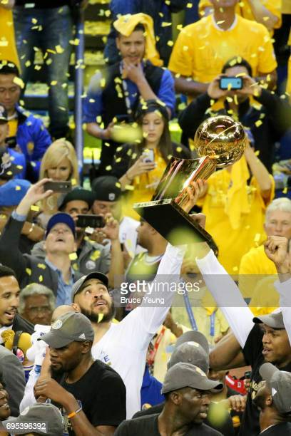 JaVale McGee and the Golden State Warriors celebrate after winning Game Five of the 2017 NBA Finals against the Cleveland Cavaliers on June 12 2017...