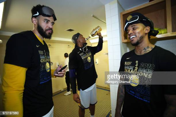JaVale McGee David West and Nick Young of the Golden State Warriors celebrate in the locker room after defeating the Cleveland Cavaliers during Game...