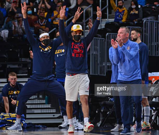 JaVale McGee, Jamal Murray and Head Coach Michael Malone of the Denver Nuggets react to a play during the game against the Portland Trail Blazers...