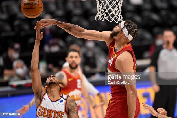 JaVale McGee of the Denver Nuggets blocks a shot attempt by Cameron Payne of the Phoenix Suns in Game Four of the Western Conference second-round...