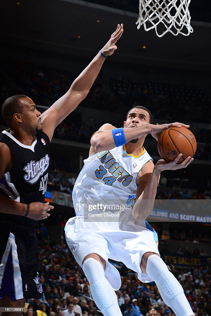 JaVale McGee #34 of the Denver Nuggets drives to the basket against Chuck Hayes #42 of the Sacramento Kings on January 26, 2013 at the Pepsi Center in Denver, Colorado.