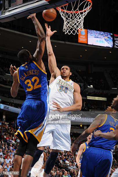 JaVale McGee of the Denver Nuggets drives to the basket against Mickell Gladness of the Golden State Warriors on April 9, 2012 at the Pepsi Center in...