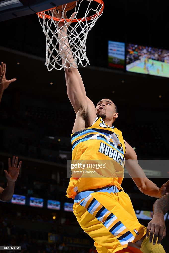 JaVale McGee #34 of the Denver Nuggets drives to the basket against the Orlando Magic on January 9, 2013 at the Pepsi Center in Denver, Colorado.