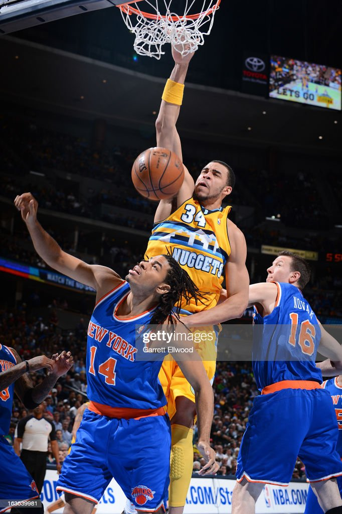 JaVale McGee #34 of the Denver Nuggets dunks against Chris Copeland #14 of the New York Knicks on March 13, 2013 at the Pepsi Center in Denver, Colorado.