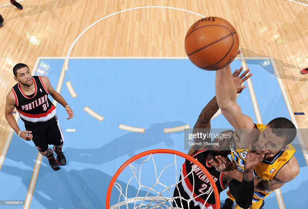 JaVale McGee #34 of the Denver Nuggets goes up for the dunk versus the Portland Trail Blazers on January 15, 2013 at the Pepsi Center in Denver, Colorado.