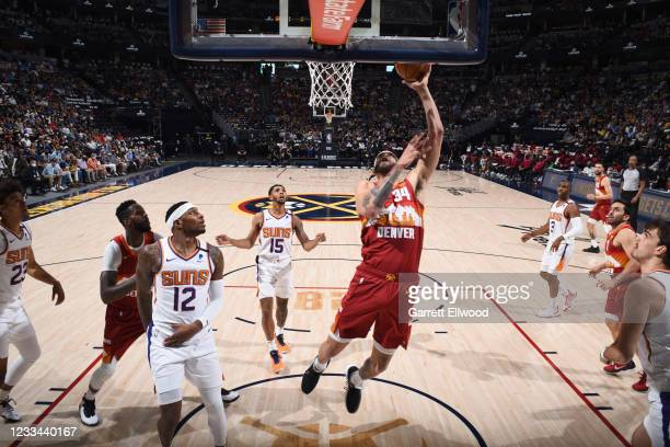 JaVale McGee of the Denver Nuggets shoots the ball during the game against the Phoenix Suns during Round 2, Game 4 of the 2021 NBA Playoffs on June...