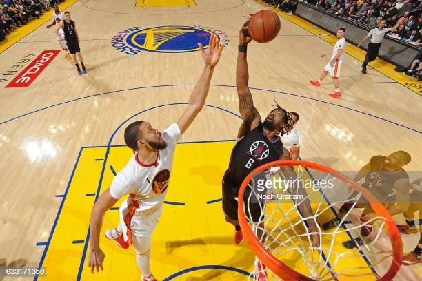 JaVale McGee of the Golden State Warriors and DeAndre Jordan of the LA Clippers go up for a rebound on January 28 2017 at oracle Arena in Oakland...