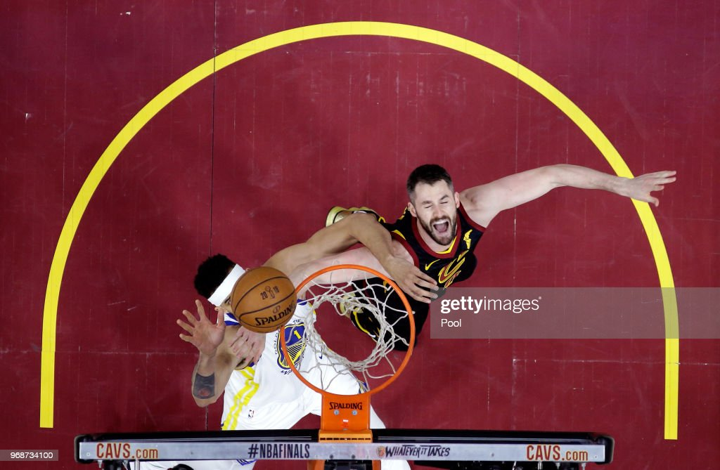 JaVale McGee #1 of the Golden State Warriors and Kevin Love #0 of the Cleveland Cavaliers battle for a rebound in the second half during Game Three of the 2018 NBA Finals at Quicken Loans Arena on June 6, 2018 in Cleveland, Ohio.