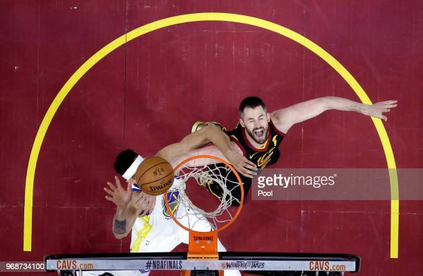 JaVale McGee of the Golden State Warriors and Kevin Love of the Cleveland Cavaliers battle for a rebound in the second half during Game Three of the...