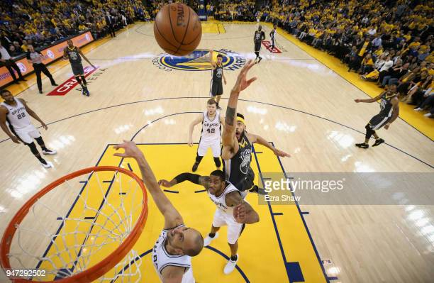 JaVale McGee of the Golden State Warriors and LaMarcus Aldridge and Manu Ginobili of the San Antonio Spurs go for a rebound during Game 2 of Round 1...