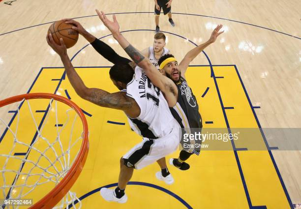 JaVale McGee of the Golden State Warriors and LaMarcus Aldridge of the San Antonio Spurs go for a rebound during Game 2 of Round 1 of the 2018 NBA...