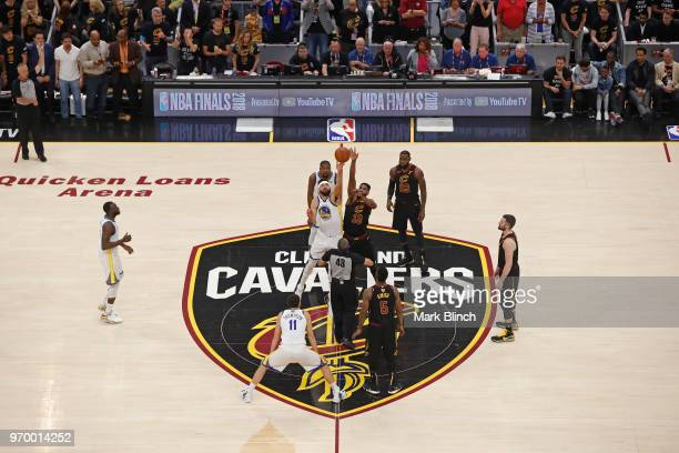 JaVale McGee of the Golden State Warriors and Tristan Thompson of the Cleveland Cavaliers go up for the opening tip off in Game Four of the 2018 NBA...