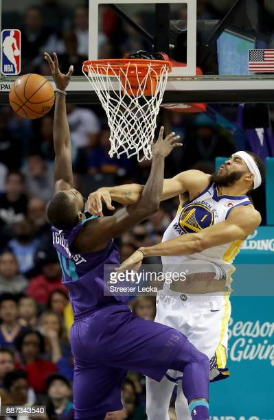 JaVale McGee of the Golden State Warriors blocks Michael KiddGilchrist of the Charlotte Hornets during their game at Spectrum Center on December 6...