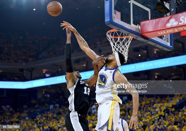 JaVale McGee of the Golden State Warriors blocks the shot of LaMarcus Aldridge of the San Antonio Spurs in the first quarter during Game One of the...