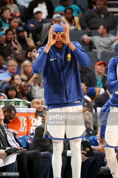 JaVale McGee of the Golden State Warriors celebrates during the game against the Charlotte Hornets on December 6 2017 at Spectrum Center in Charlotte...