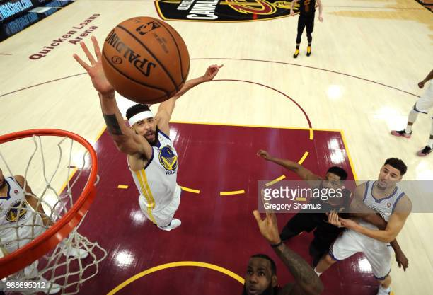 JaVale McGee of the Golden State Warriors defends a layup by LeBron James of the Cleveland Cavaliers in the first quarter during Game Three of the...