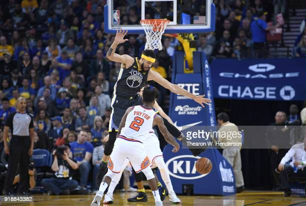 JaVale McGee of the Golden State Warriors defends the pass of Elfrid Payton of the Phoenix Suns during an NBA basketball game at ORACLE Arena on...