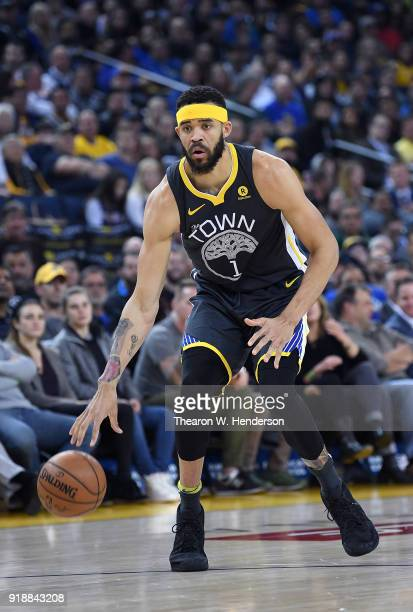 JaVale McGee of the Golden State Warriors dribbles the ball against the Phoenix Suns during an NBA basketball game at ORACLE Arena on February 12...