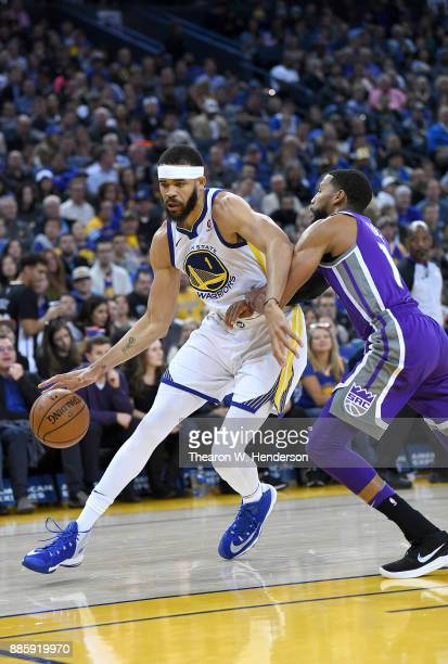 JaVale McGee of the Golden State Warriors drives on Garrett Temple of the Sacramento Kings during their NBA basketball game at ORACLE Arena on...