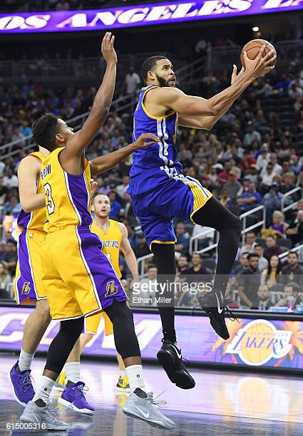 JaVale McGee of the Golden State Warriors drives to the basket against Anthony Brown of the Los Angeles Lakers during their preseason game at TMobile...