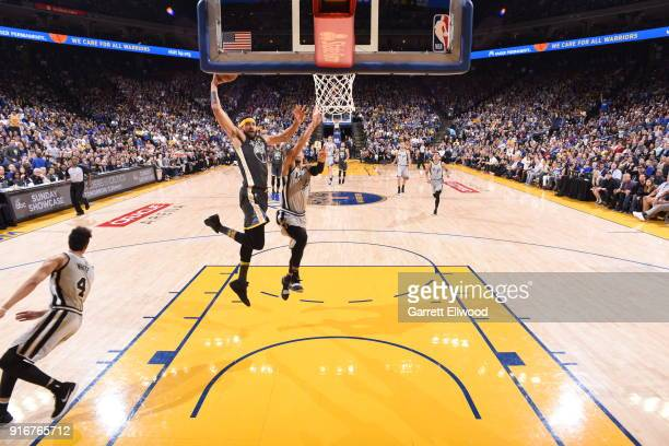 JaVale McGee of the Golden State Warriors drives to the basket against the San Antonio Spurs on February 10 2018 at Oracle Arena in Oakland...