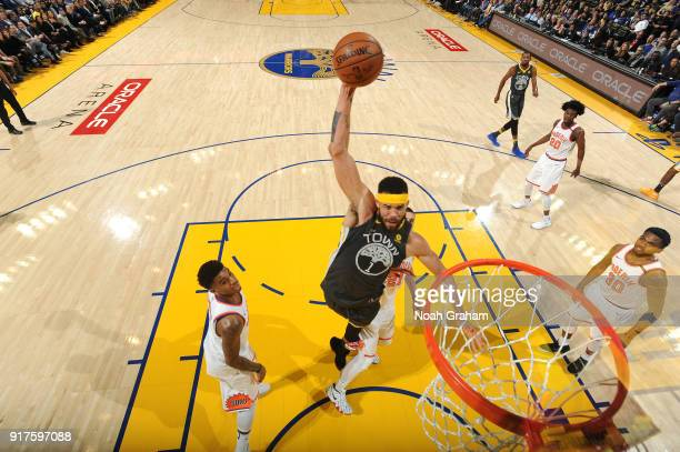 JaVale McGee of the Golden State Warriors dunks against the Phoenix Suns on February 12 2018 at ORACLE Arena in Oakland California NOTE TO USER User...
