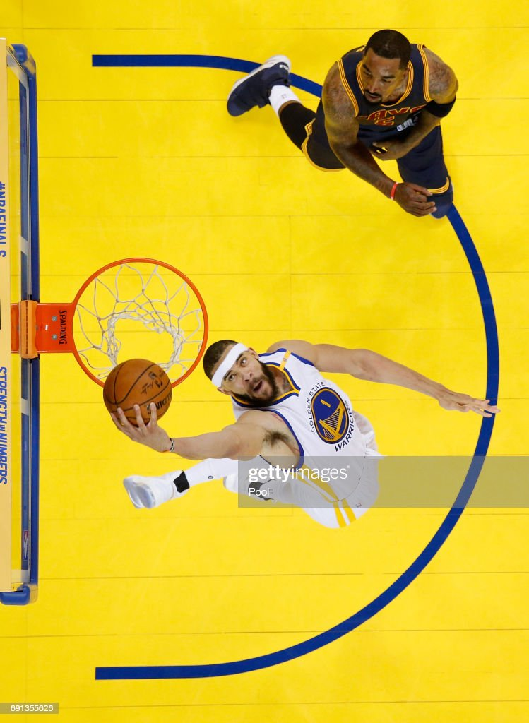 JaVale McGee #1 of the Golden State Warriors dunks the ball against JR Smith #5 of the Cleveland Cavaliers in Game 1 of the 2017 NBA Finals at ORACLE Arena on June 1, 2017 in Oakland, California.