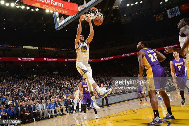 JaVale McGee of the Golden State Warriors dunks the ball against the Los Angeles Lakers on November 23 2016 at ORACLE Arena in Oakland California...
