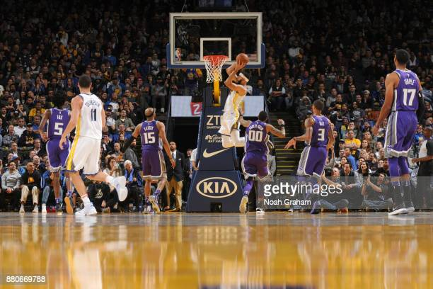 JaVale McGee of the Golden State Warriors dunks the ball against the Sacramento Kings on November 27 2017 at ORACLE Arena in Oakland California NOTE...