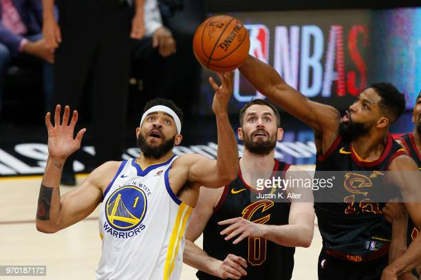 JaVale McGee of the Golden State Warriors fights for a rebound with Kevin Love and Tristan Thompson of the Cleveland Cavaliers during Game Four of...