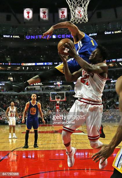 JaVale McGee of the Golden State Warriors fouls Jimmy Butler of the Chicago Bulls at the United Center on March 2 2017 in Chicago Illinois NOTE TO...