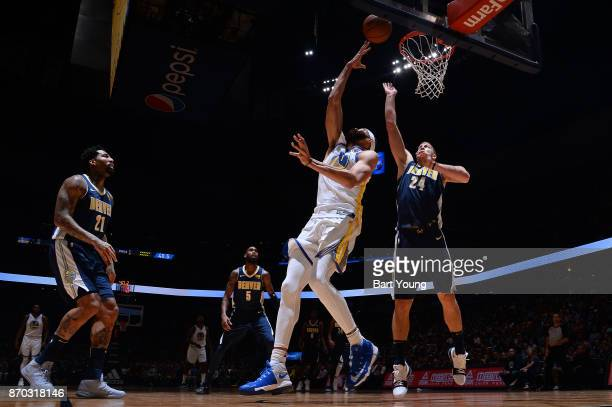 JaVale McGee of the Golden State Warriors goes to the basket against the Denver Nuggets on November 4 2017 at the Pepsi Center in Denver Colorado...