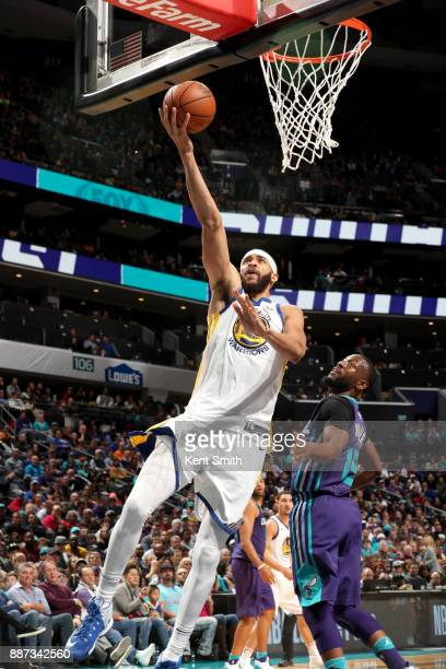 JaVale McGee of the Golden State Warriors goes to the basket against the Charlotte Hornets on December 6 2017 at Spectrum Center in Charlotte North...