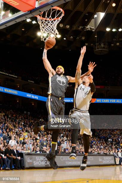 JaVale McGee of the Golden State Warriors goes up for a dunk against Danny Green of the San Antonio Spurs on February 10 2018 at ORACLE Arena in...