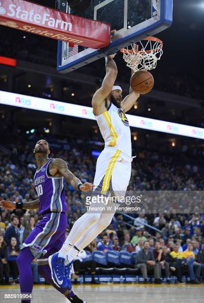 JaVale McGee of the Golden State Warriors goes up for a slam dunk against the Sacramento Kings during their NBA basketball game at ORACLE Arena on...
